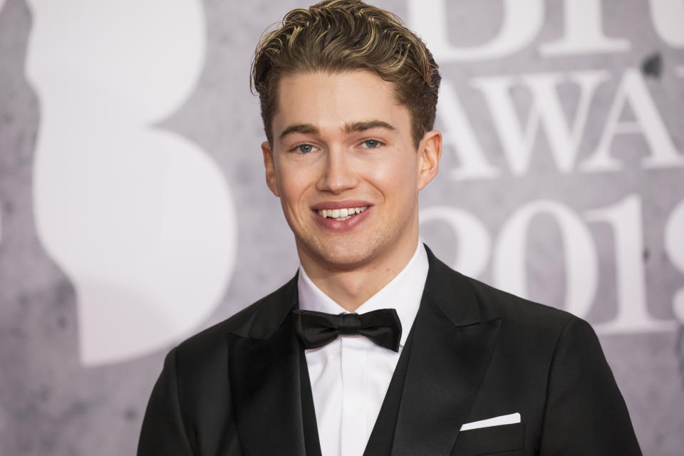 AJ Pritchard poses for photographers upon arrival at the Brit Awards in London, Wednesday, Feb. 20, 2019. (Photo by Vianney Le Caer/Invision/AP)