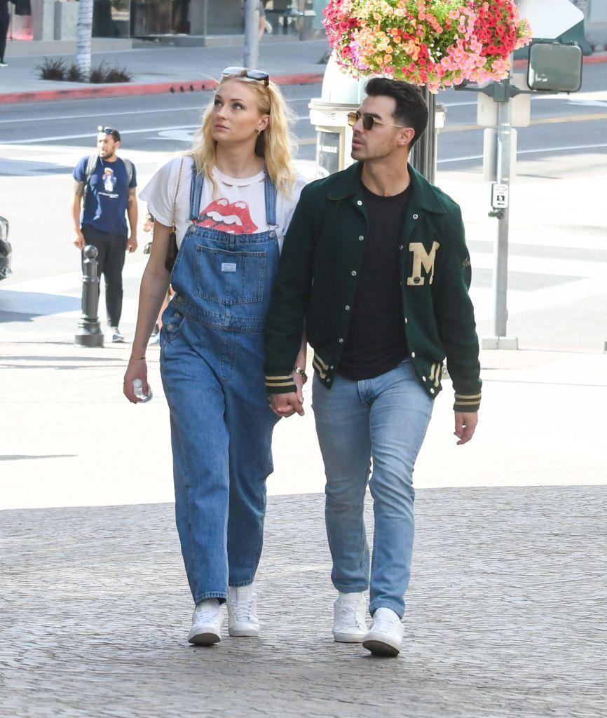 <p>The couple enjoyed a low key stroll around LA on Friday, both wearing denim. Sophie teamed her vintage-look denim overalls with a Rolling Stone logo tee while Joe paired his light jeans with a black t-shirt and a baseball jacket.</p>