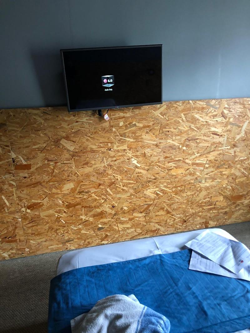 Image of wooden panneling with LG TV on coronavirus self-isolation hotel in Newtown
