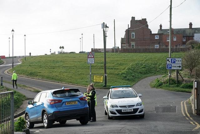 Police speak to drivers at Tynemouth beach