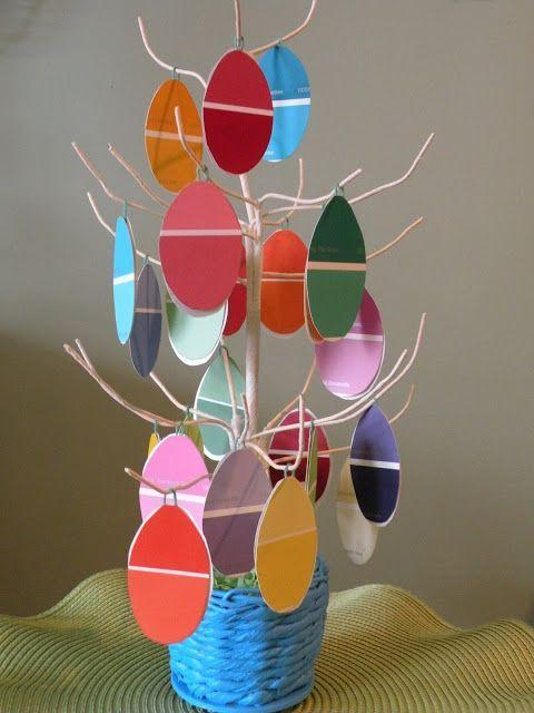 """<p>You don't have to spend a lot to make a cute Easter display. Just grab some paper paint samples from the hardware store and a pair of scissors and you're well on your way to crafting the colorful egg ornaments seen here. </p><p><strong>Get the tutorial at <a href=""""https://www.onemilehomestyle.com/2013/03/paint-chip-easter-tree.html"""" rel=""""nofollow noopener"""" target=""""_blank"""" data-ylk=""""slk:One Mile Home & Style"""" class=""""link rapid-noclick-resp"""">One Mile Home & Style</a>.</strong></p><p><a class=""""link rapid-noclick-resp"""" href=""""https://www.amazon.com/EAMBRITE-Easter-Jewelry-Centerpiece-Wedding/dp/B07M6VW37W/ref=sr_1_1_sspa?tag=syn-yahoo-20&ascsubtag=%5Bartid%7C10050.g.26498744%5Bsrc%7Cyahoo-us"""" rel=""""nofollow noopener"""" target=""""_blank"""" data-ylk=""""slk:SHOP TWIG TREES"""">SHOP TWIG TREES</a></p>"""