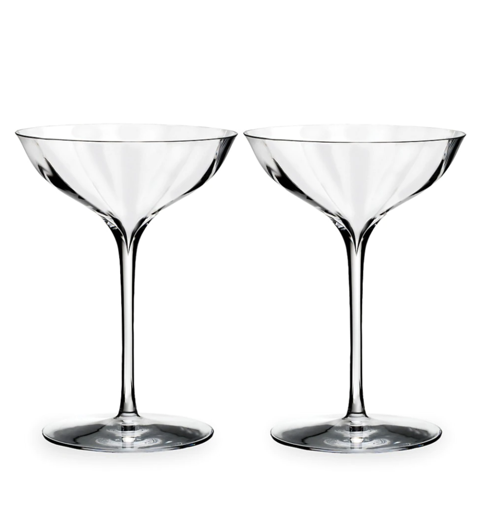 """<p><strong>Waterford Set of Two Elegance Optic Belle Coupe Glasses</strong></p><p>saksfifthavenue.com</p><p><strong>$80.00</strong></p><p><a href=""""https://go.redirectingat.com?id=74968X1596630&url=https%3A%2F%2Fwww.saksfifthavenue.com%2Fproduct%2Fwaterford-set-of-two-elegance-optic-belle-coupe-glasses-0400098820045.html&sref=https%3A%2F%2Fwww.veranda.com%2Fluxury-lifestyle%2Fentertaining%2Fg36491087%2Fhome-bar-accessories%2F"""" rel=""""nofollow noopener"""" target=""""_blank"""" data-ylk=""""slk:Shop Now"""" class=""""link rapid-noclick-resp"""">Shop Now</a></p><p>Michalopoulos says there's just something about a beautiful cocktail glass that rounds out the imbibing experience, especially at Bemelmans Bar. He advises stocking up on a variety of classic cocktail glass shapes: rocks, highball, collins, coupe, and martini. </p>"""