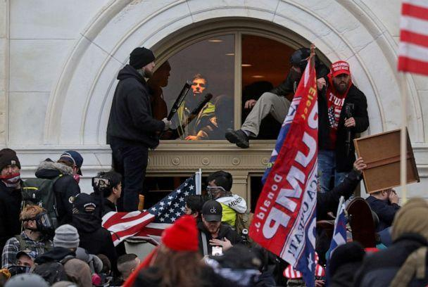FILE PHOTO: A mob of supporters of then-U.S. President Donald Trump climb through a window they broke as they storm the U.S. Capitol Building in Washington, U.S., January 6, 2021.  (Leah Millis/Reuters)