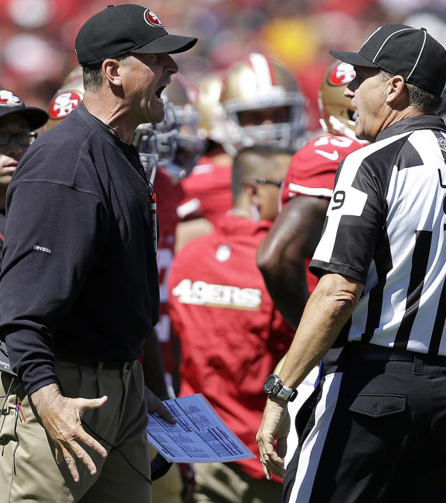 San Francisco 49ers head coach Jim Harbaugh yells at line judge Mark Perlman (9) after quarterback Colin Kaepernick was tackled by Green Bay Packers outside linebacker Clay Matthews during the second quarter of an NFL football game in San Francisco, Sunday, Sept. 8, 2013. (AP Photo/Marcio Jose Sanchez)