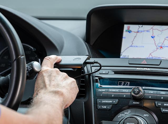 Echo Auto plugs into a car's 12V power outlet or built-in USB port and connects to the in-car stereo via either audio jack cable or Bluetooth. (Getty)