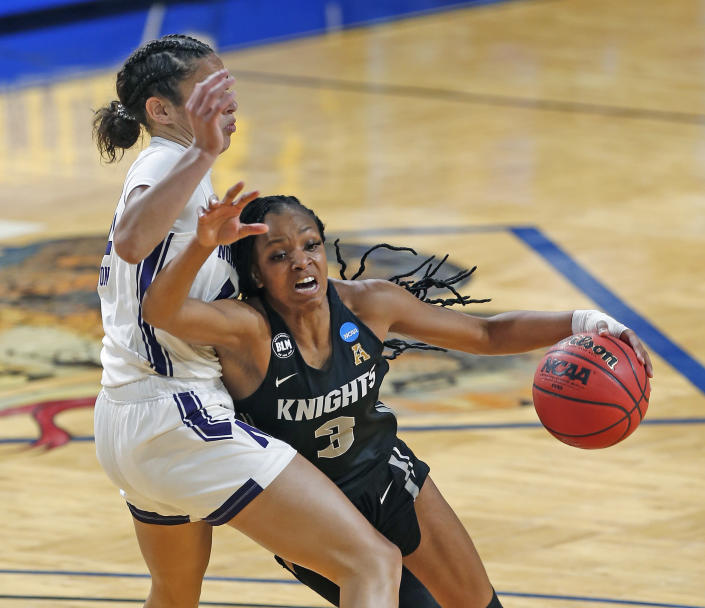 CORRECTS TO MONDAY, MARCH 22, 2021-UCF guard Diamond Battles (3) drives on Northwestern guard Veronica Burton (12) during the first half of a college basketball game in the first round of the women's NCAA tournament at the Greehey Arena in San Antonio, Texas, Monday, March 22, 2021. (AP Photo/Ronald Cortes)