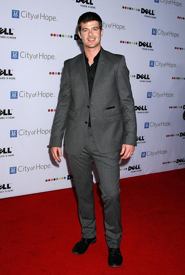 """Lost Without U"" singer Robin Thicke flashed his pearly whites while sporting a simple gray suit. Jeffrey Mayer/<a href=""http://www.wireimage.com"" target=""new"">WireImage.com</a> - October 15, 2008"