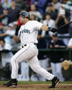 FILE - In this Oct. 3, 2004, file photo, Seattle Mariners' Edgar Martinez makes the final swing of his career, against the Texas Rangers, in Seattle. Martinez finished with a .312 career average in 18 seasons, all with Seattle. Martinez was elected to baseball's Hall of Fame Tuesday, Jan. 22, 2019. (AP Photo/Elaine Thompson, File)