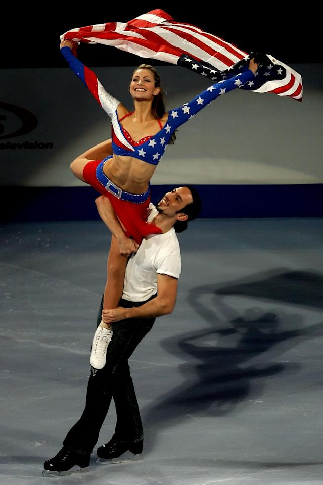 <p>American Tanith Belbin took patriotism to another level in her bedazzled USA inspired ice dancing dress. Her partner, Benjamin Agosto, was more understated in a white shirt and black pants. </p>