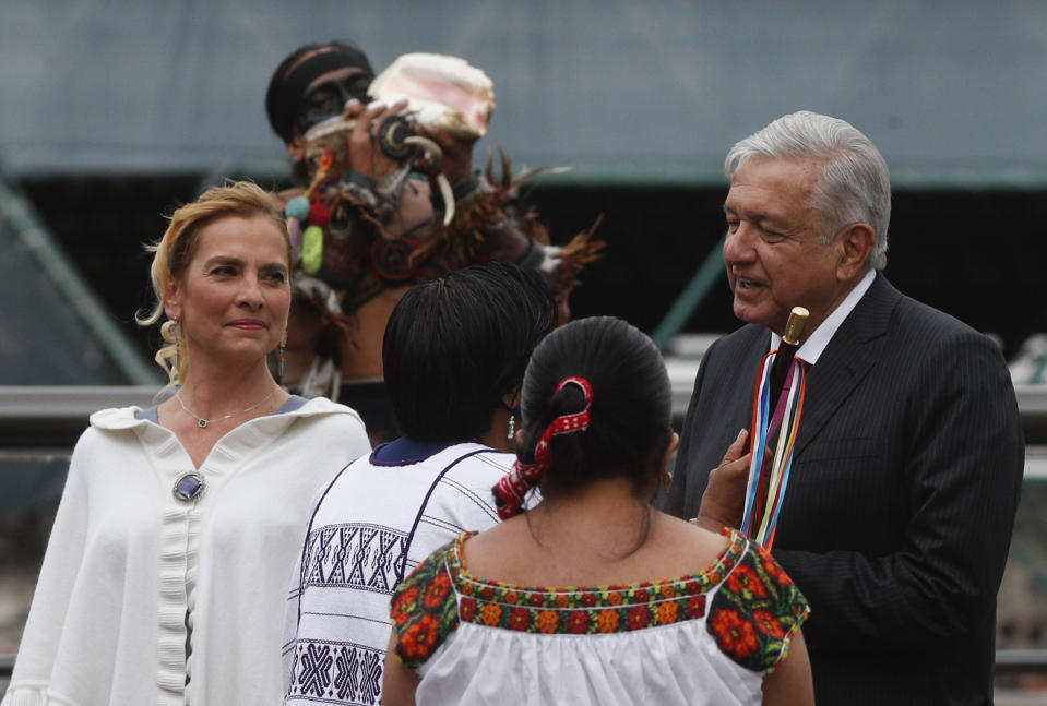 Mexican President Andres Manuel Lopez Obrador and his wife Beatriz Gutierrez Muller attend a ceremony marking the 700 year anniversary of the founding of Tenochtitlan, known as Mexico City, at the Templo Mayor archeological site in Mexico City, Thursday, May 13, 2021. (AP Photo/Eduardo Verdugo)