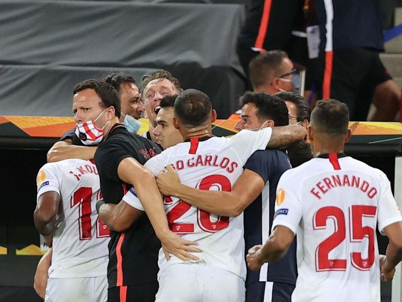 Sevilla players celebrate during the Europa League final against Inter Milan: Getty Images