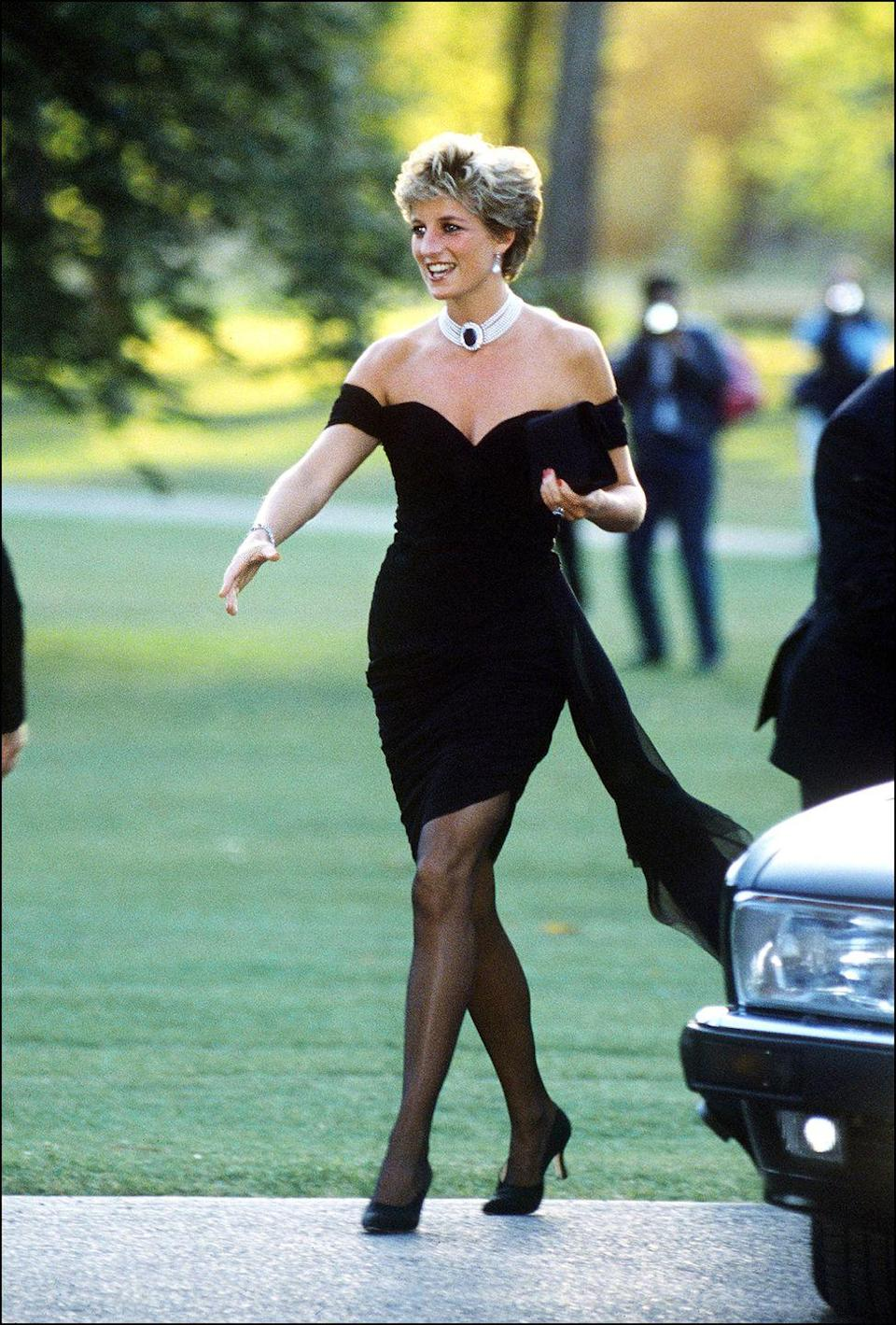 <p>In an off-the-shoulder black dress by Christina Stambolian and a choker arriving at the Serpentine Gallery in London. </p>