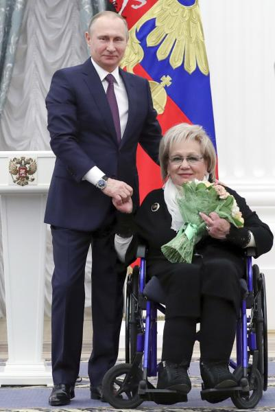 FILE - In this Friday, April 28, 2017 file photo, Russian President Vladimir Putin presents a medal to art director of the Sovremennik theater Galina Volchek at the award ceremony in the Kremlin in Moscow, Russia. Volchek, a prominent theater director and actress, died in Moscow Thursday, Dec. 26, 2019 at the age of 86.(Mikhail Klimentyev/Sputnik, Kremlin Pool Photo via AP)