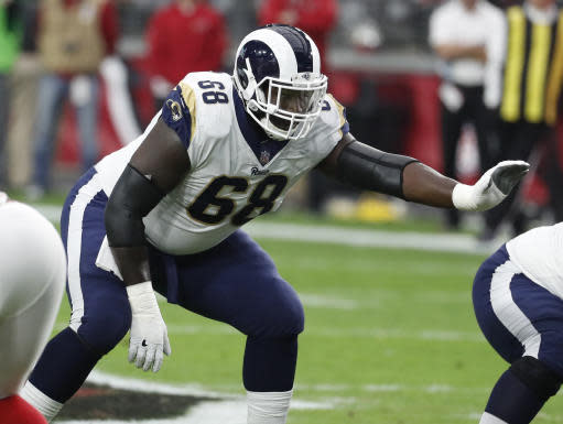 FILE - In this Dec. 3, 2017, file photo, Los Angeles Rams offensive guard Jamon Brown (68) gets ready for a play during the first half of the team's NFL football game against the Arizona Cardinals in Glendale, Ariz. Brown is back with the Rams offensive line after a two-game suspension for violating the NFLs substances of abuse policy. If Brown isnt in the starting lineup when the Rams host the Chargers on Sunday, Sept. 23, the right guard doesnt sound overly disappointed about the decision. Brown knows just how well Austin Blythe played in his unfortunate absence. (AP Photo/Rick Scuteri, File)