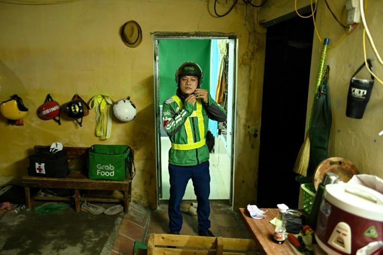 By day, Pham Quoc Viet works for ride-hailing firm Grab but at night he is an unofficial emergency responder