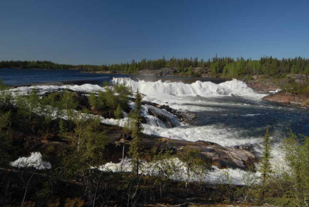 The South Valley spillway on the Taltson River. Two of three 'small gates' at the Nonacho Lake Dam have been opened to keep Nonacho Lake within the parameters of its water licence for the Taltson Hydro facility, the Northwest Territories Power Corporation said in a news release on Friday.  (N.W.T. Power Corporation  - image credit)