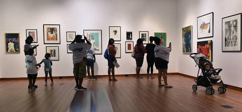 Families enjoy an exhibit at the Harvey B. Gantt Center for African-American Arts + Culture. The center has been the only African, Latinx, Asian, Arab or Native American organization to receive operating support grants consistently from the Arts & Science Council, ASC officials said.