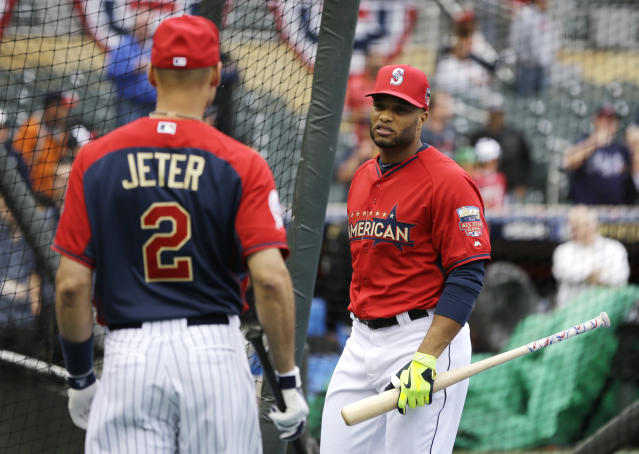 American League second baseman Robinson Cano, of the Seattle Mariners, right, talks with teammate short stop Derek Jeter, of the New York Yankees, during batting practice for the MLB All-Star baseball game, Monday, July 14, 2014, in Minneapolis. (AP Photo/Jeff Roberson)