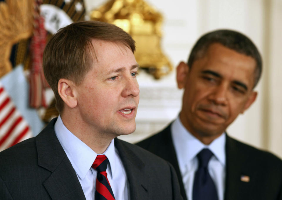 U.S. President Barack Obama (R) stands next to Richard Cordray after Obama announced Cordray's renomination to lead the Consumer Financial Protection Bureau in the State Dining Room of the White House in Washington, January 24, 2013.  REUTERS/Larry Downing  (UNITED STATES - Tags: POLITICS BUSINESS)