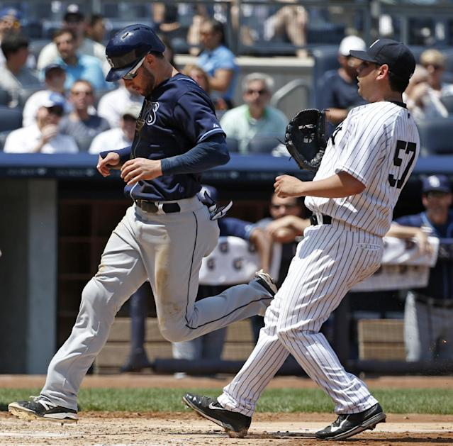 New York Yankees starting pitcher Vidal Nuno covers the plates as Tampa Bay Rays' Kevin Kiermaier (39) scores on a third-inning passed ball in a baseball game at Yankee Stadium in New York, Wednesday, July 2, 2014. (AP Photo/Kathy Willens)