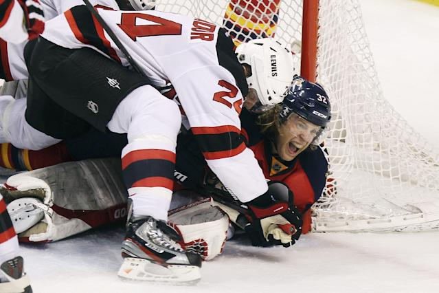 Florida Panthers' Kris Versteeg (32) reacts after New Jersey Devils' Bryce Salvador (24) was unable to stop Versteeg's goal during the second period of Game 1 of an NHL hockey Stanley Cup first-round playoff series in Sunrise, Fla., Friday, April 13, 2012. (AP Photo/J Pat Carter)