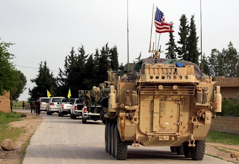 US forces, accompanied by Kurdish People's Protection Units (YPG) fighters, drive their armored vehicles near the northern Syrian village of Darbasiyah, on the border with Turkey in April 2017 (AFP Photo/DELIL SOULEIMAN)