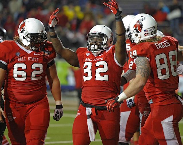 Ball State running back Jahwan Edwards (32) celebrates his fourth touchdown against Arkansas State in the fourth quarter of the GoDaddy Bowl NCAA college football game in Mobile, Ala., Sunday, Jan. 5, 2014. (AP Photo/G.M. Andrews)