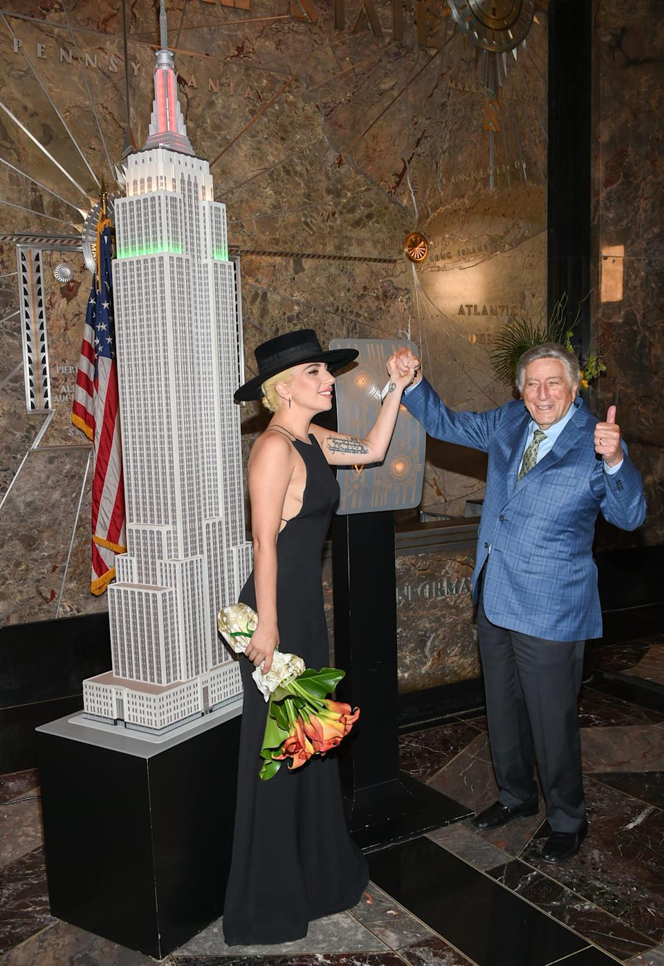 Singers Tony Bennett, right, and Lady Gaga appear at a ceremony to light the Empire State Building in honor of Bennett's 90th birthday on Wednesday, Aug. 3, 2016, in New York.