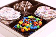 """<p>Send a little something sweet to friends and family you can't see in person this year. This 15-piece gift box features pretzels dipped in white, milk and dark chocolate, and dressed up with colorful candy for the holidays! </p> <p><strong>Buy It!</strong> Confetti Collection, $40; <a href=""""https://poshpretzels.com/shop/gift-boxes/confetti-collection/"""" rel=""""nofollow noopener"""" target=""""_blank"""" data-ylk=""""slk:poshpretzels.com"""" class=""""link rapid-noclick-resp"""">poshpretzels.com</a></p>"""