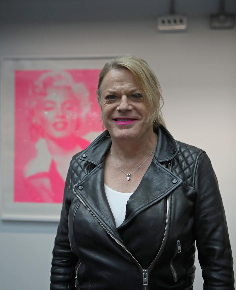 Eddie Izzard in front of David Studwell's Marilyn Monroe, Candy Floss Pink-Diamond Dust (Framed) which is priced at £1,195 , during a preview for the Icons Exhibition at Riverside Studios in London. (Photo by Luciana Guerra/PA Images via Getty Images)
