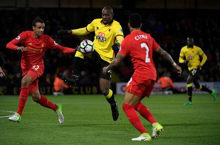 Britain Football Soccer - Watford v Liverpool - Premier League - Vicarage Road - 1/5/17 Watford's Stefano Okaka in action with Liverpool's Joel Matip and Nathaniel Clyne Reuters / Toby Melville Livepic