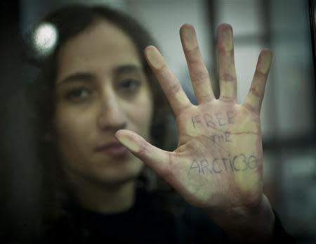 Greenpeace handout shows activist Faiza Oulahsen of the Netherlands displaying a message on her palm during a bail hearing at the Murmansk Regional Court