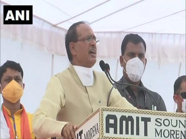 MP CM Shivraj Singh Chouhan addressing a poll rally in Morena on Friday.