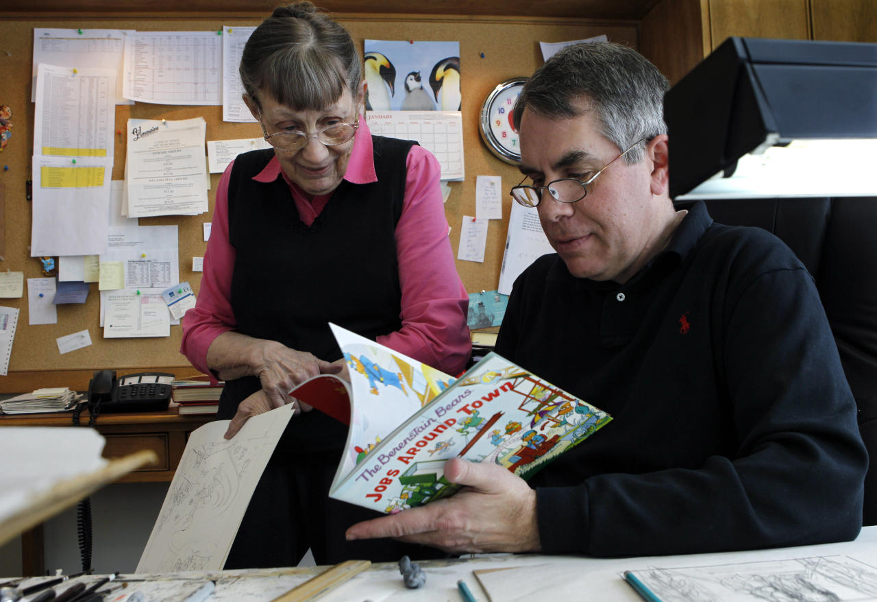 In this Jan. 25, 2011 photo, Mike Berenstain and his mother, Janice Berenstain, look at an earlier Berenstain Bears book as they work in their studio in Solebury, Pa. It used to be husband and wife Jan and Stan Berenstain creating the books, but their son Mike took over when his father died, thus continuing the tradition that started with the first book in 1962.