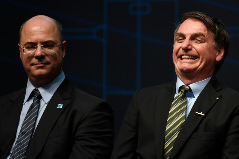 Rio de Janeiro's Governor Wilson Witzel (L) and Brazilian President Jair Bolsonaro attend the ceremony marking the assembly of the parts of Brazil's new Navy submarine Humaita (SBR-2), at the Itaguai Navy Complex in Rio de Janeiro, Brazil, on October 11, 2019. (Photo by MAURO PIMENTEL / AFP) (Photo by MAURO PIMENTEL/AFP via Getty Images)