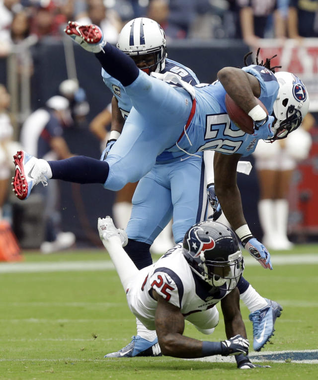 Tennessee Titans' Chris Johnson (28) is upended by Houston Texans' Kareem Jackson (25) during the first quarter of an NFL football game Sunday, Sept. 15, 2013, in Houston. (AP Photo/Patric Schneider)