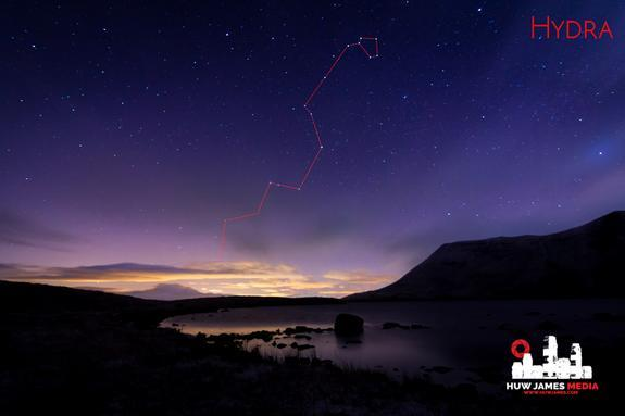 The slithering head of Hydra, marked in red, moves its way into the northern latitudes, seen here of the pristine lake of Llyn y Fan Fach in the Brecon Beacons Dark Sky Reserve in Wales, U.K.