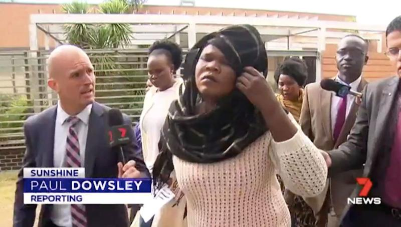 Ayou Deng leaves court flanked by supporters. Source: 7 News