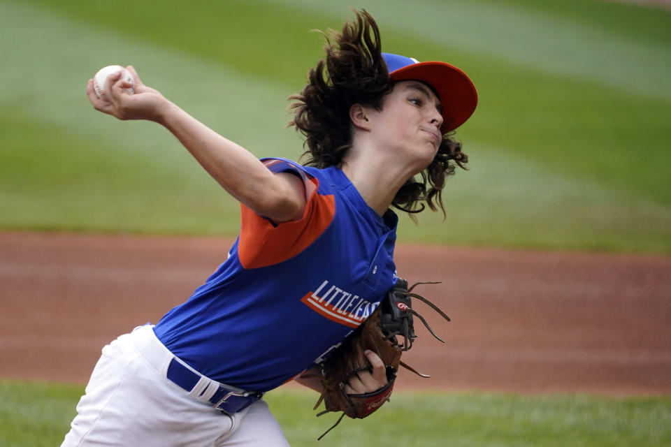 Taylor, Mich.'s Ethan Van Belle delivers during the first inning of the Little League World Series Championship baseball game against Hamilton, Ohio, in South Williamsport, Pa., Sunday, Aug. 29, 2021. (AP Photo/Gene J. Puskar)