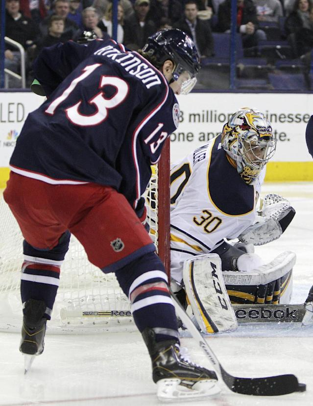 Buffalo Sabres' Ryan Miller, right, makes a save against Columbus Blue Jackets' Cam Atkinson during the second period of an NHL hockey game, Saturday, Jan. 25, 2014, in Columbus, Ohio. The Sabres won 5-2. (AP Photo/Jay LaPrete)