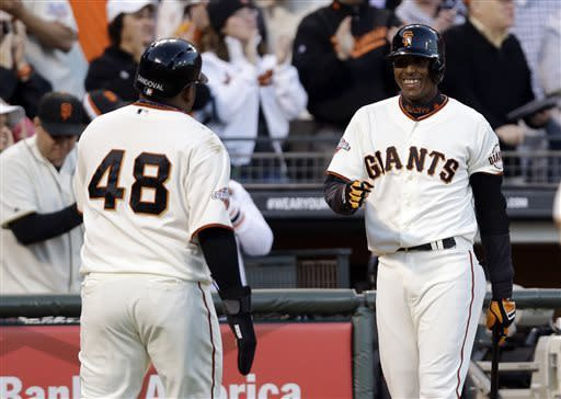 San Francisco Giants' Pablo Sandoval (48) celebrates with Joaquin Arias after Sandoval scored on a double by Buster Posey during the first inning of a baseball game on Monday, April 22, 2013, in San Francisco. (AP Photo/Marcio Jose Sanchez)