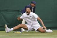 Australia's Nick Kyrgios slips after playing a return to Ugo Humbert of France during the men's singles first round match on day three of the Wimbledon Tennis Championships in London, Wednesday June 30, 2021. (Jon Super/Pool via AP)