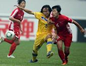 Thailand's Kanjana Sung-ngoen (C) fights for the ball with North Korea's Yun Song-mi during a qualifier for the 2012 London Olympic Games, in Jinan, eastern China's Shandong province, in 2011. Pyongyang announced in early June that 51 athletes had qualified in 11 sports for London, with its main medal hopes in weightlifting, wrestling and women's football