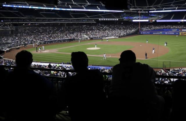 Fans watch the second inning of a baseball game between the Tampa Bay Rays and the New York Yankees at Citi Field Monday, Sept. 11, 2017, in New York. (AP Photo/Frank Franklin II)