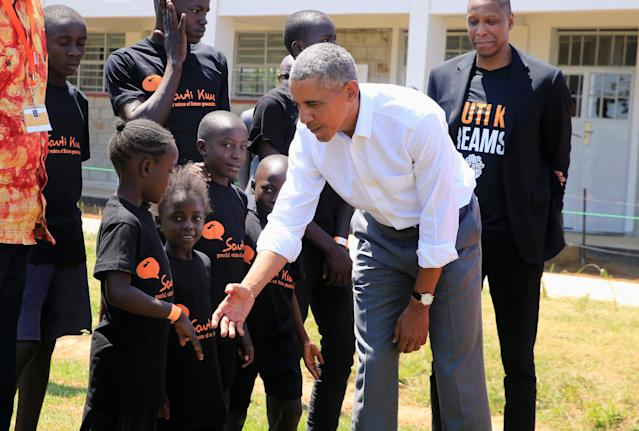 <p>Former U.S. President Barack Obama meets children as he tours the Sauti Kuu resource centre near his ancestral home in Nyangoma Kogelo village in Siaya county, western Kenya July 16, 2018. (Photo: Thomas Mukoya/Reuters) </p>