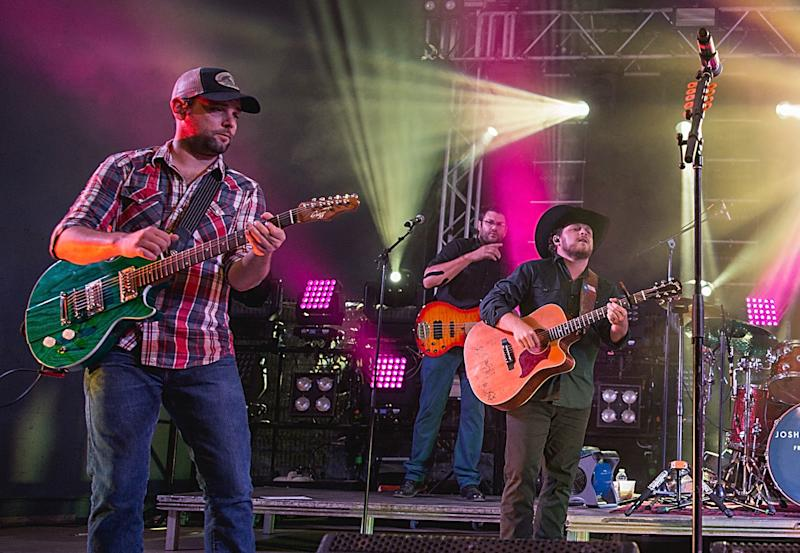 Caleb Keeter, left, performs with the Josh Abbott Band in 2016.