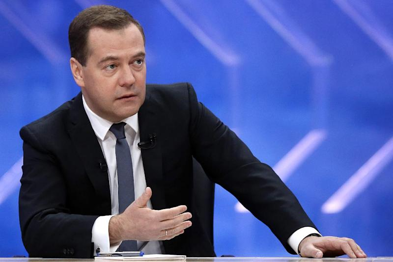 Russian Prime Minister Dmitry Medvedev speaks during an interview at the Ostankino television center in Moscow on December 10, 2014
