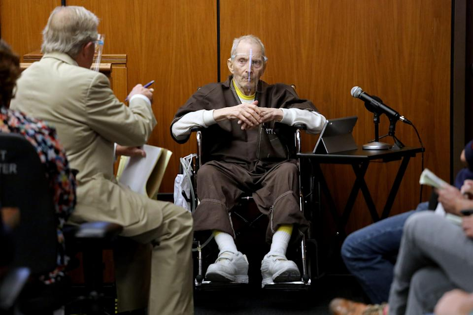 Robert Durst, 78, New York real estate scion, answers questions from defense attorney Dick DeGuerin, left, on Aug. 9 during his murder trial in California.