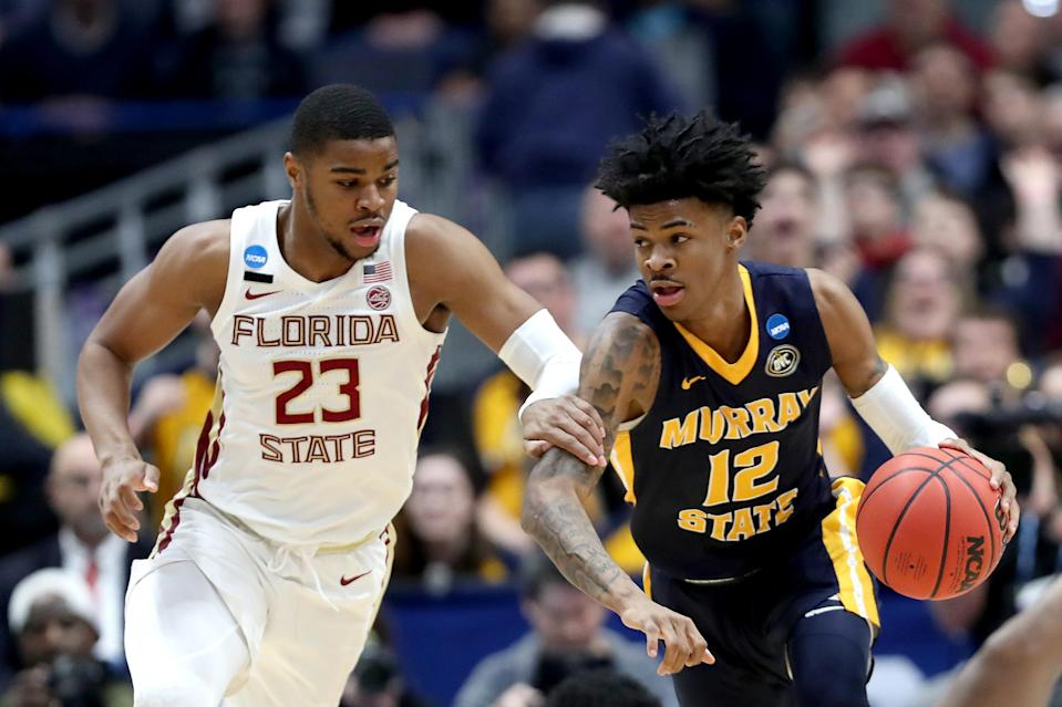 <p>Ja Morant #12 of the Murray State Racers is defended by M.J. Walker #23 of the Florida State Seminoles in the first half during the second round of the 2019 NCAA Men's Basketball Tournament at XL Center on March 23, 2019 in Hartford, Connecticut. (Photo by Rob Carr/Getty Images) </p>