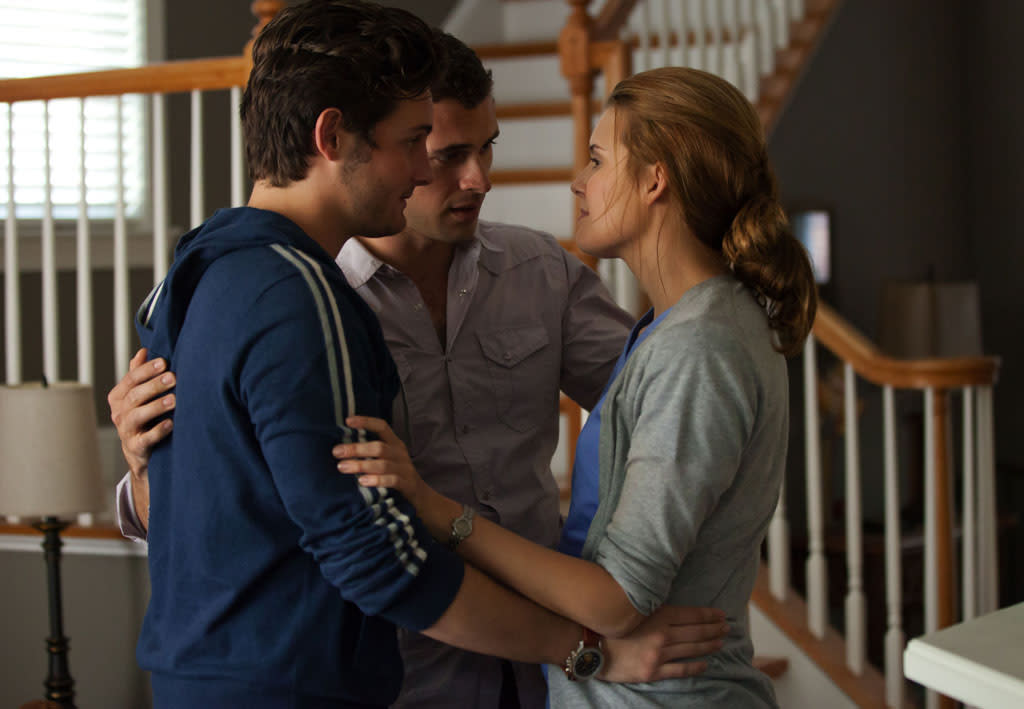 "Sarah Fuller (guest star Maggie Grace) finds comfort in her two friends, Will (Nico Tortorella) and Billy (Adan Canto), in the series premiere of ""The Following."""